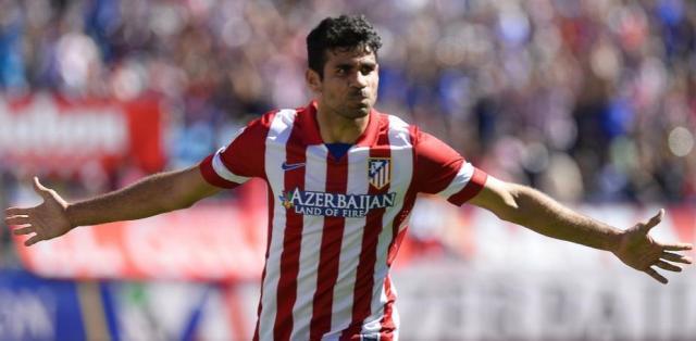 Diego Costa comemora gol pelo Atlético de Madri pelo Campeonato Espanhol (FOTO: PIERRE-PHILIPPE MARCOU / AFP)